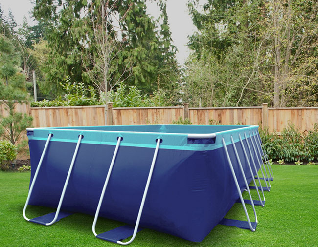 Summer Breeze Above Ground Pool set up on grass.